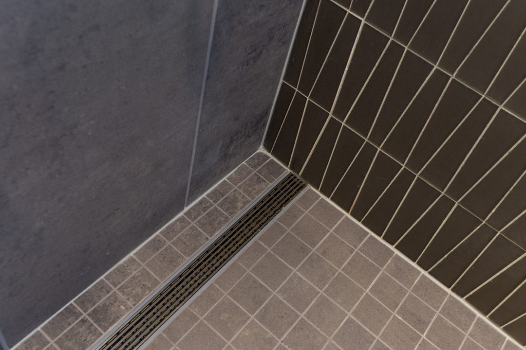Unpolished 2x2 General Grey Tile o Shower Back wall and wall behind tub: Waveline Mosaic Glass Tile, Smoke Mosaic glass tile, Smoke tile with white grout, glass tile, vertical stacked tile, Empire Unpolished 12x24 Generals Grey Tile, Unpolished 12x24 grey floor tile