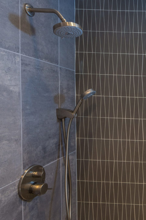 Unpolished 2x2 General Grey Tile o Shower Back wall and wall behind tub: Waveline Mosaic Glass Tile, Smoke Mosaic glass tile, Smoke tile with white grout, glass tile, vertical stacked tile,