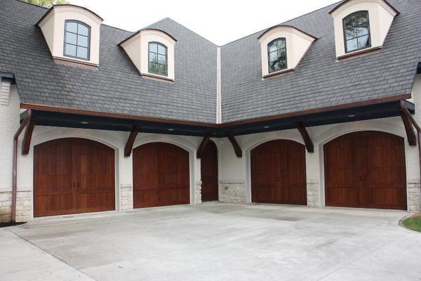 Custom carriage doors, exterior garage doors, copper gutters