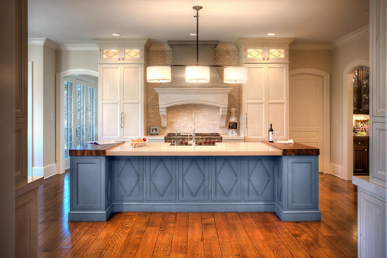 New Kitchen, Central Island with Bar, Modern Three Shade Pendant Light Over Island, Custom Kitchen Cabinets, Walnut Slab Counter Tops, Pewter Range Hood