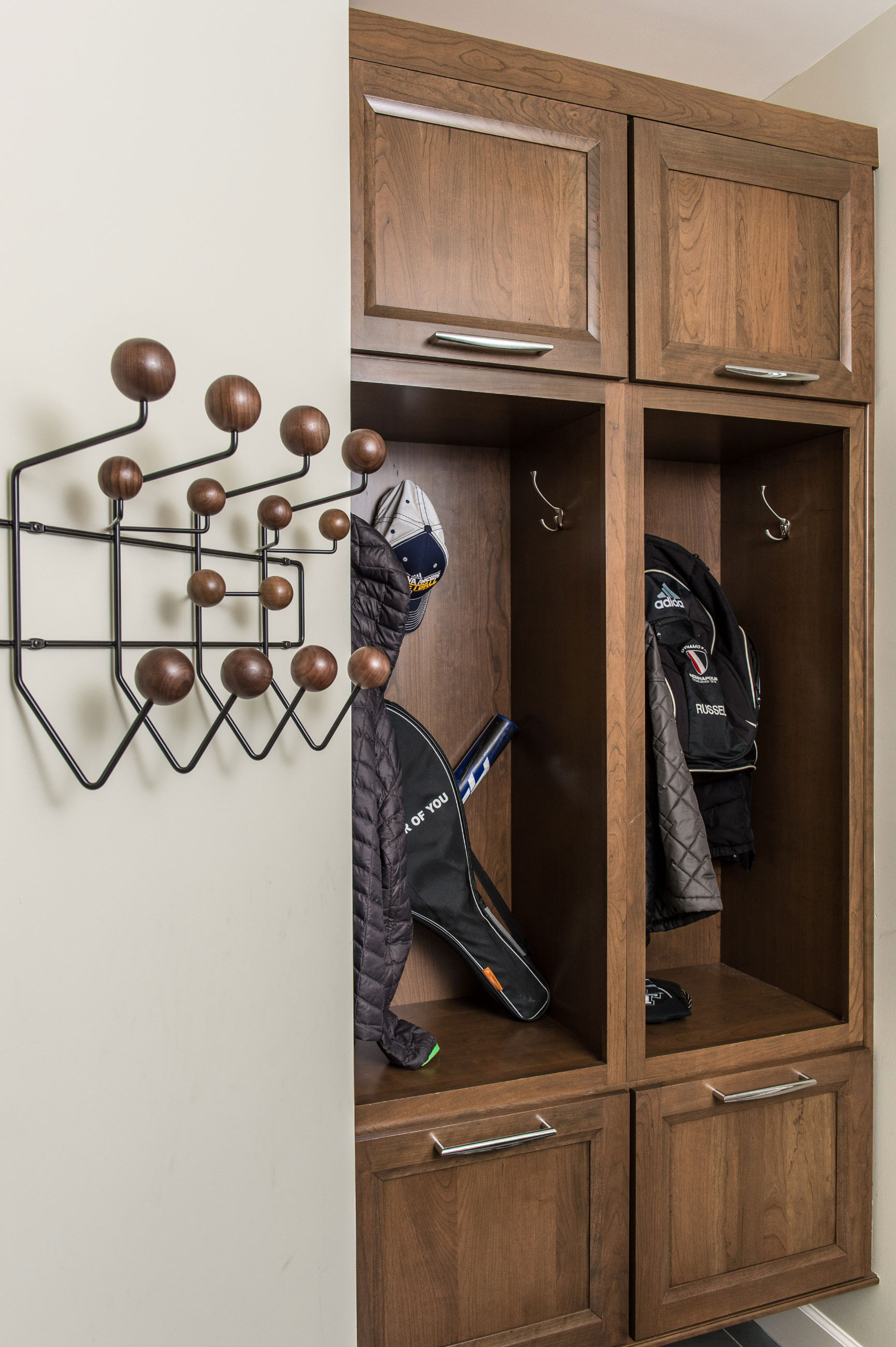 Mudroom Cubbies are custom designed and fabricated. Laundry Cabinetry is Aristokraft