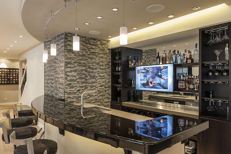 basement bar, quartz counters, wood bar top, pendant lighting, mirrored backsplash, curved bar
