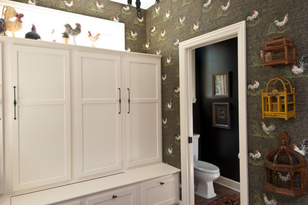 mud room with built in lockers, powder room