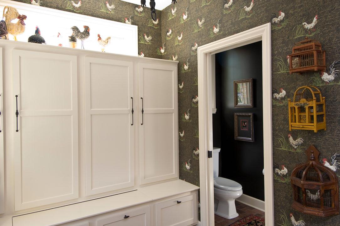 mud room with built in lockers, powder room