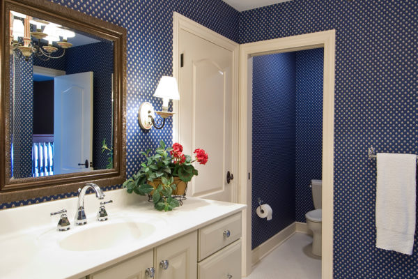 painted finish chandelier, navy polka dot wallpaper, custom height vanity