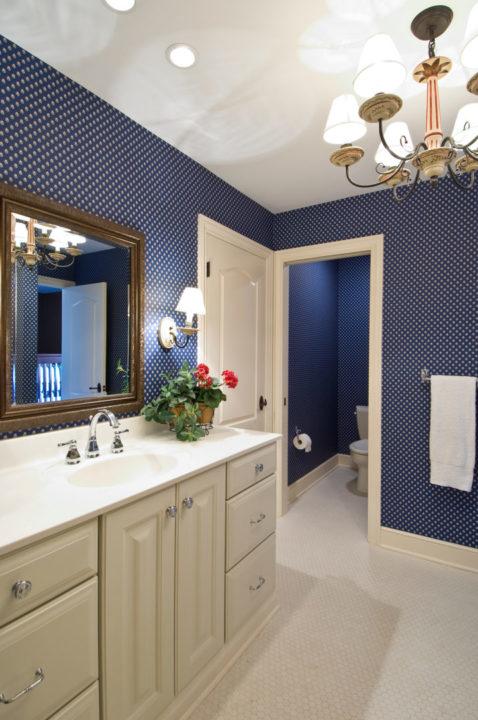 painted finish chandelier, navy polka dot wallpaper, custom height vanity