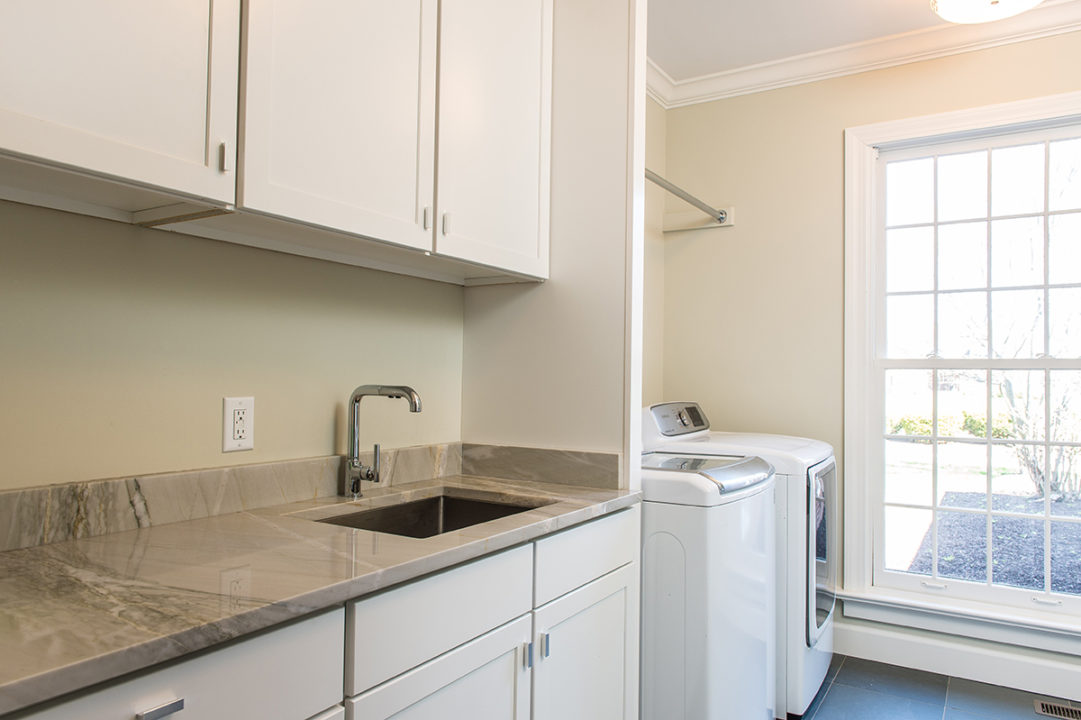 Laundry room remodel with utility sink and custom cabinets