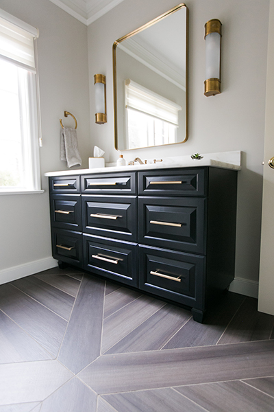 Black stained vanity cabinets with gold drawer pulls, Mediterranean dream series tile, radiant floor heat, vintage gold sconces, custom floor tile