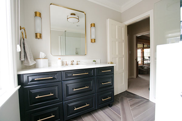 Black stained vanity cabinets with gold drawer pulls, Mediterranean dream series tile, radiant floor heat, vintage gold sconces, custom floor tile, EF Champion Oxford Sconces