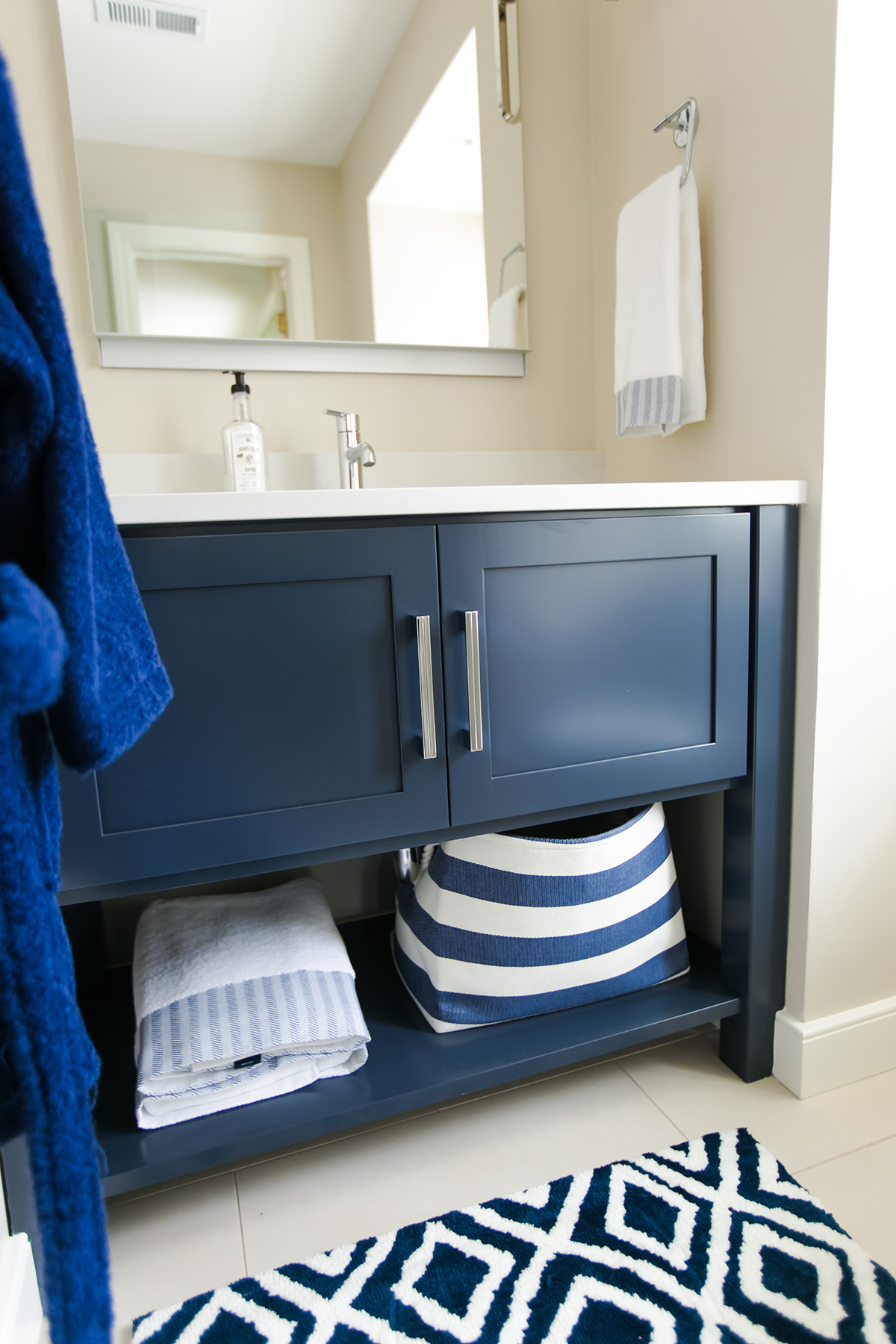 kids nautical bathroom, blue and white bathroom, hudson valley lightening, hudson valley lightning, build in medicine cabinet, open shelf bathroom vanity, red hook pendant lights, trinsic faucet