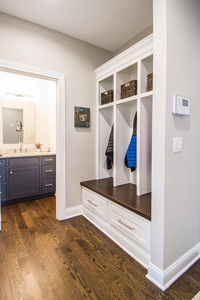 mud room with backpack cubbies