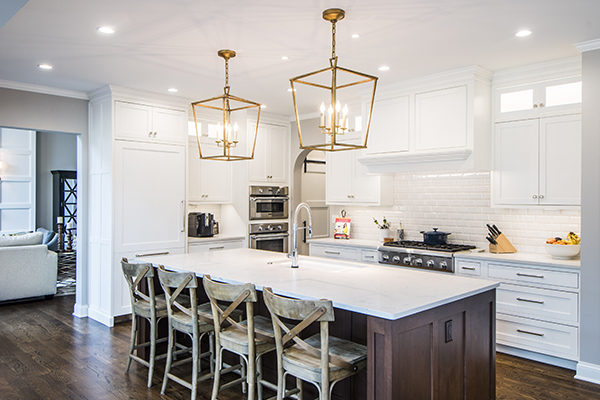 kitchen island with gold chandeliers
