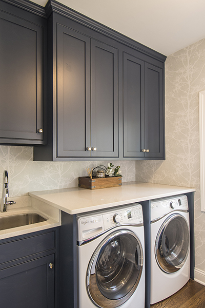 slate blue laundry room with under mount sink