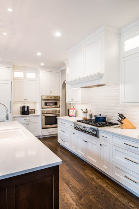 white modern kitchen with stainless steel appliances