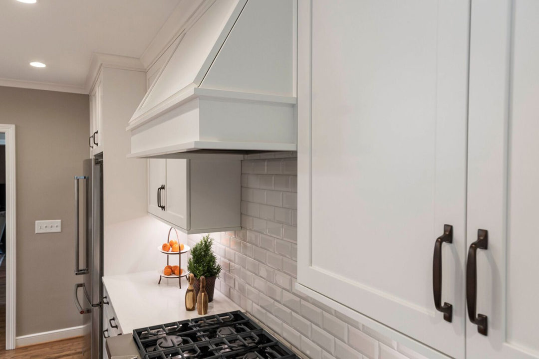 Shaker Style Cabinet, White Painted Cabinets, Countertops: Caesarstone, Frosty Carrina Quartz counters
