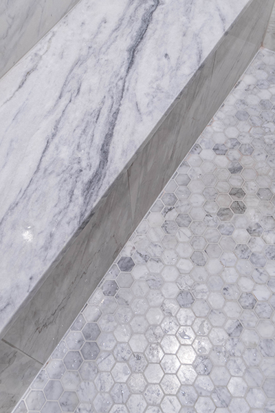 "Shower Floor and Niches in shower are Casteel 2"" Hexagon Carrara Venatino. Polished Shower Walls are Marmol Venatino Polished 18x18 tile"