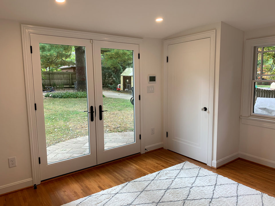 mudroom, vaulted ceiling, storage options , bench, lockers, french doors