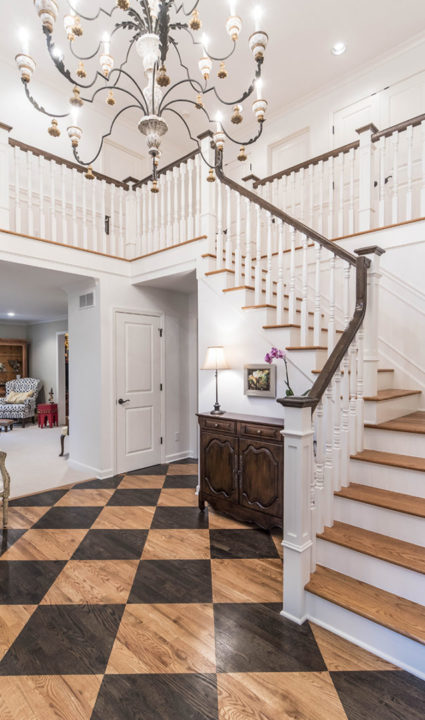 two story entry with custom wood floor diamond pattern