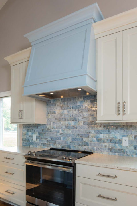 Pilbara Habitat Series by Maniscalco Australian Mosaics, Color Tidal, blue tile backsplash, kitchen backsplash, unique tile, GE Appliances (built in dishwasher and counter depth fridge), stainless appliances, Vortex Hood Liner, GE Profile Built in microwave and trim kit