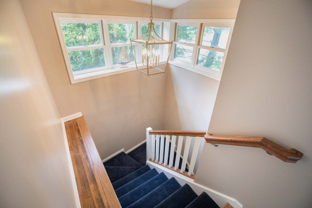 Stairs with highlight windows, open concept