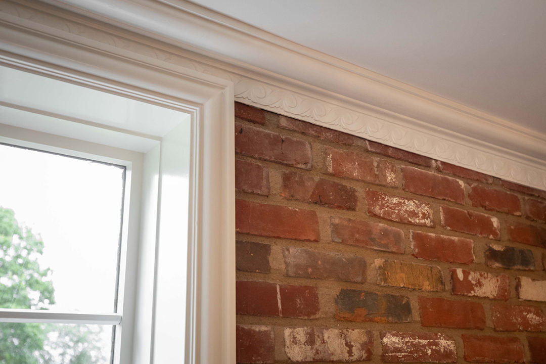 brick accent wall, crown molding detail