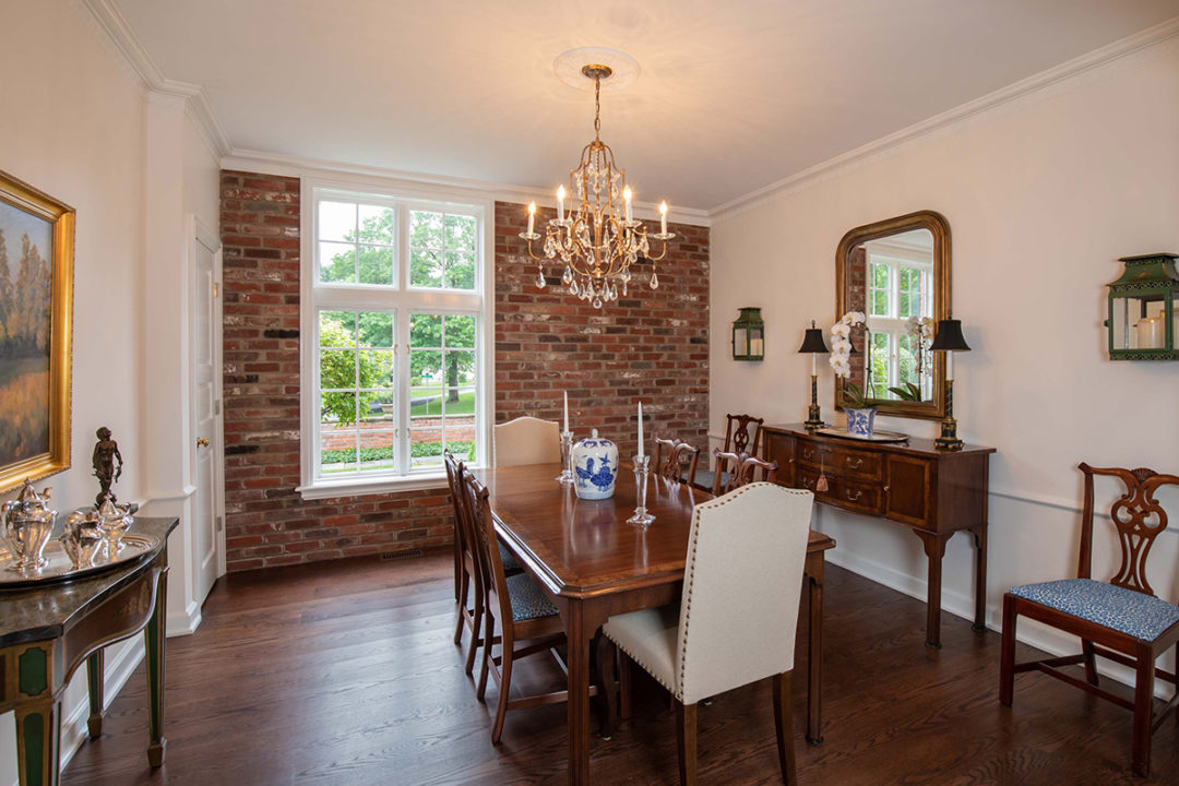 brick accent wall, Thayer 3 light chandelier, Antique gold pendants