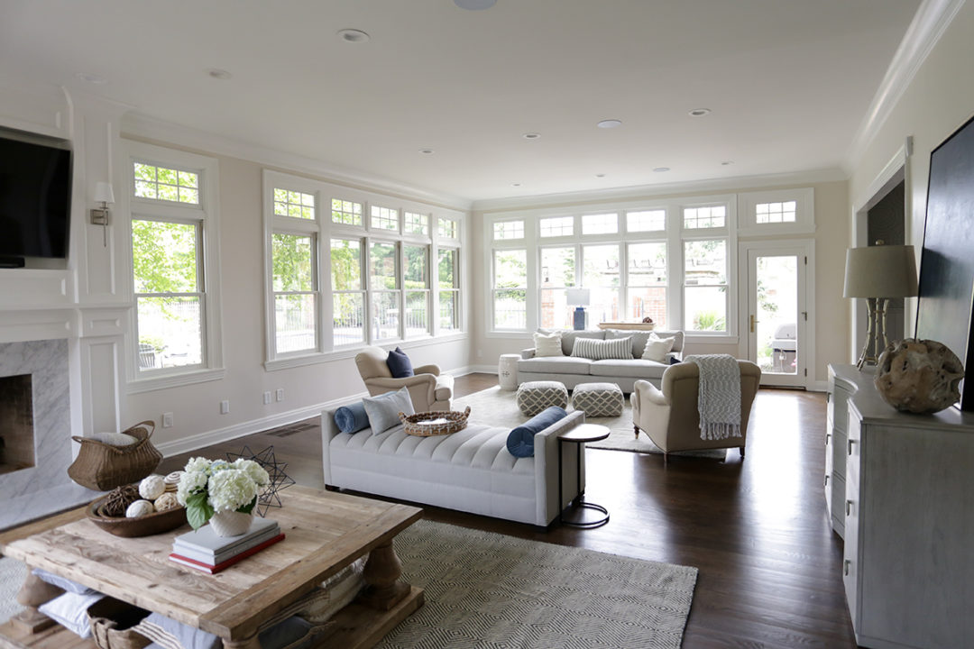 white family room, floor to ceiling windows, fireplace