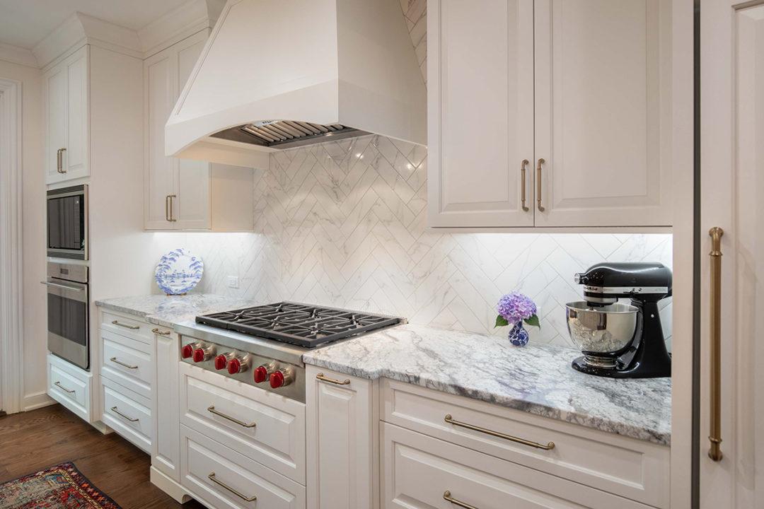 - White-gray-kitchen-herringbone-backsplash - Corinthian Fine Homes