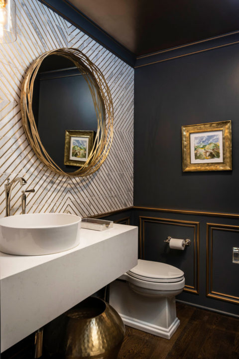 "Champagne bronze plumbing fixtures, vessel bowl sink, custom wall tile patterns, unique wall tile layout, wall tile 72"" high, Black and Gold Bathroom, Painted Ceiling in Bathroom, Gold Leaf Painted Trim, Round Hibiscus Vessel Bowl Sink by Mirabelle, Charlotte Vessel Faucet by Brizo in polished nickel, Round contemporary bottle trap by kohler, Tresham toilet by Kohler, Mitzi Niko Pendant Lights by Hudson Valley (aged brass), Frosty Carrina Caesarstone Quartz with 10"" mitred front and side."