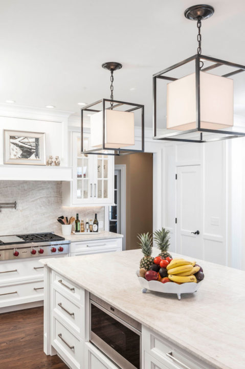 custom white painted, glass front cabinetry, inset panel cabinetry, Paras Stone tops, small ogee island top profile, white kitchen, undercounter lighting, wolf appliances
