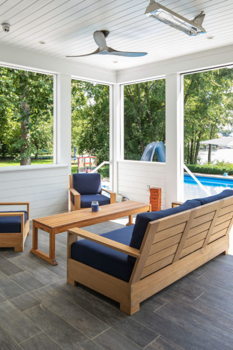 Custom Built TV Cabinet with remote control up and down, nickel gap siding cabinetry, retractable TV lift, Porcelain plank tile, Mirage Noon Charcoal Plank Tile, Ceiling Fans and Infra-tech surface mount heaters, Outdoor living space, indoor-outdoor living space, covered porch, lakehouse exterior,