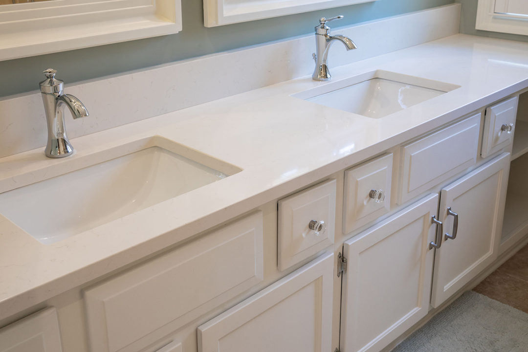 Tapquartz White #27347 remnant countertop, Traditional Classics knobs and Westerley pulls by Amerock, finish: Satin Nickel, Cabinetry Hardware
