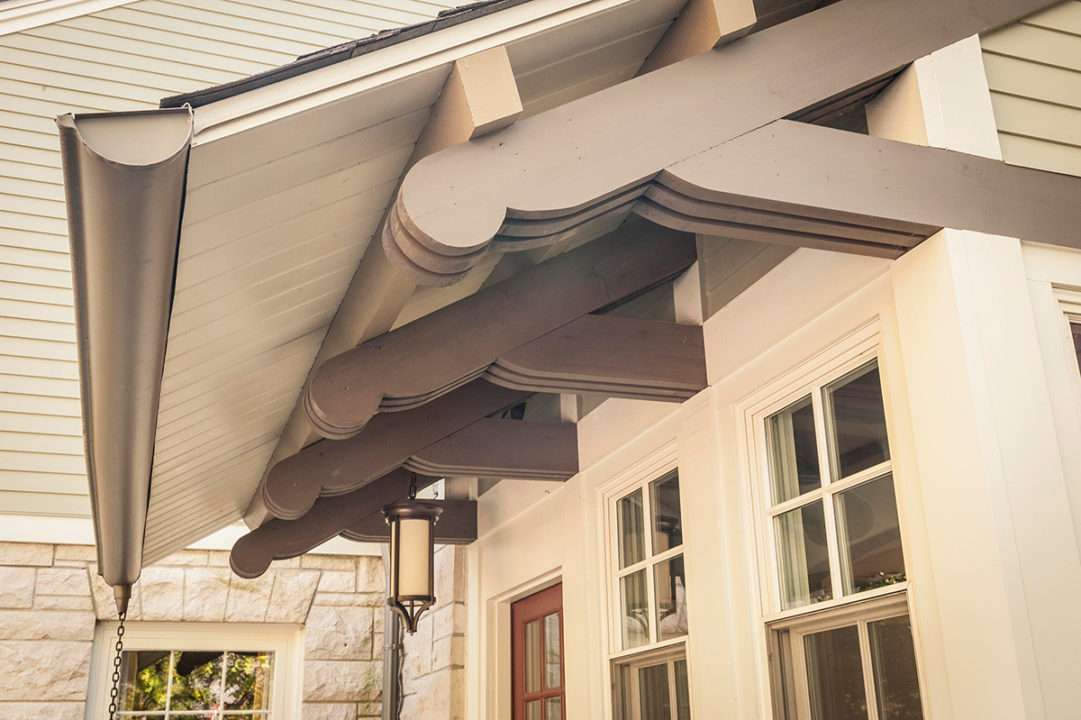 bracketed corbels, half round gutters, chain link downspouts, clap board siding