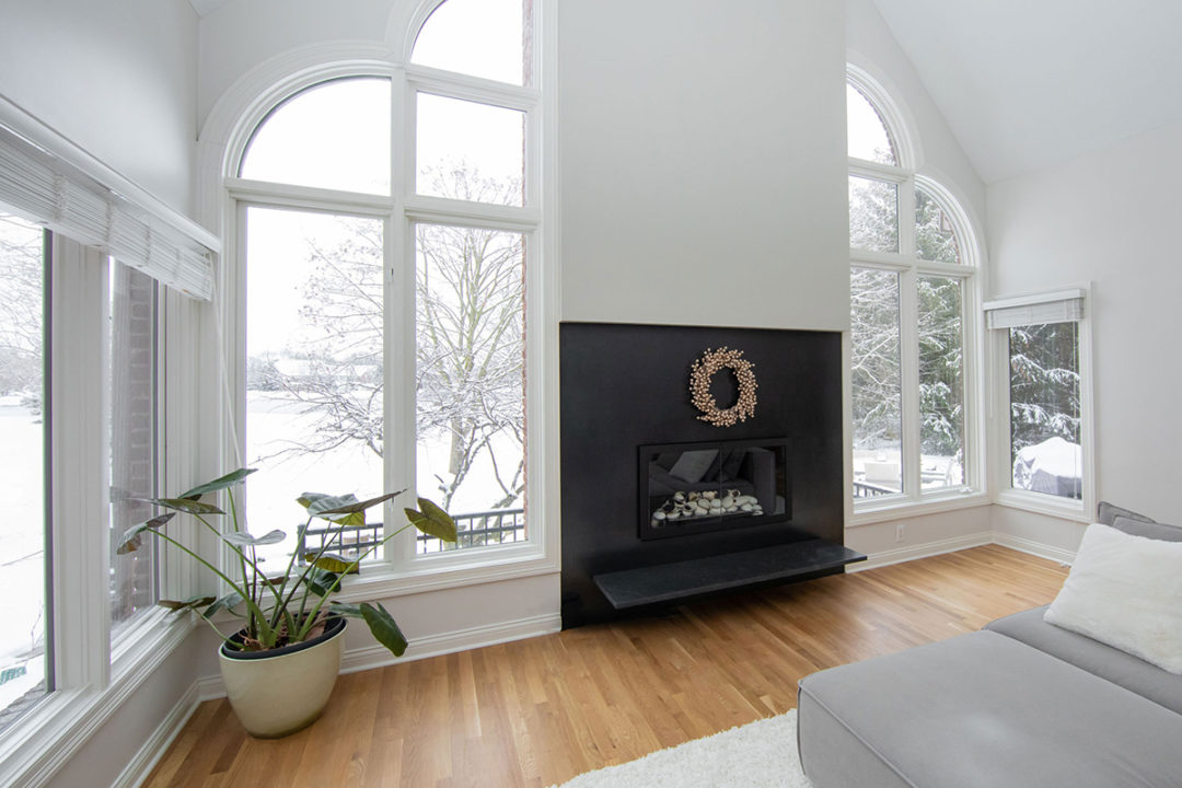 clean lines, sleek and simple, fresh white, floating hearth granite fireplace, steel slab surround, oak hardwood floors