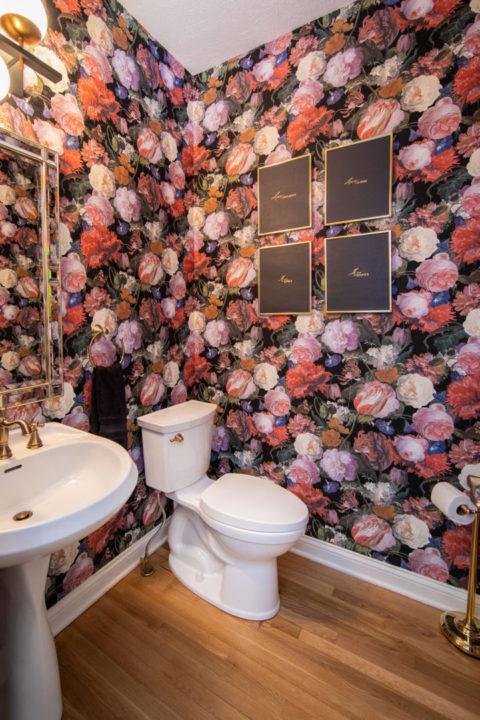 powder bath, wallpaper, pedestal sink, brass plumbing and light fixtures