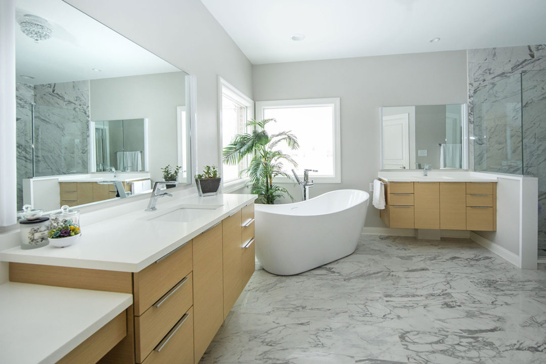 Delta plumbing fixtures, modern light fixtures, contemporary light fixtures, clean lines, sleek and simple, fresh white, free standing tub, his and her vanities, undermount sink, quartz countertops, porcelain tile