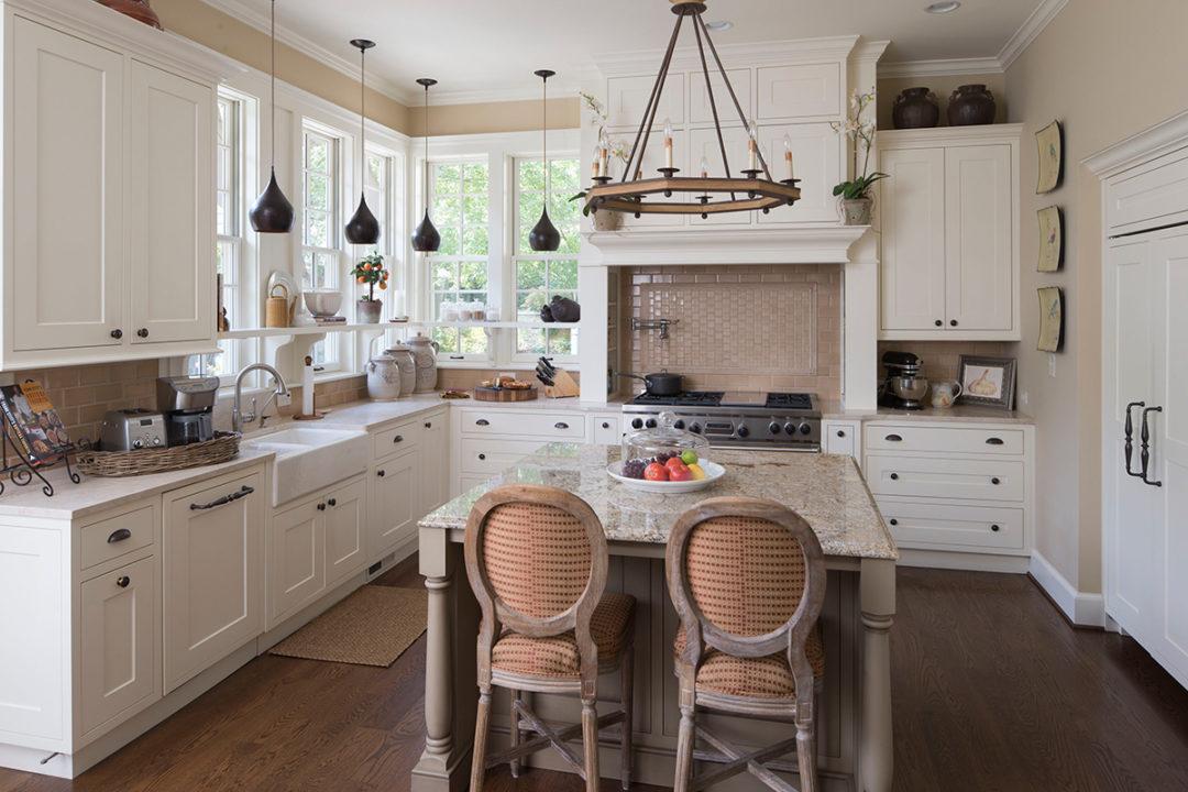 snset cabinet doors, flat panel shaker style doors, farm sink, pot filler faucet, center island, window shelf, built in refrigerator, bronze hardware