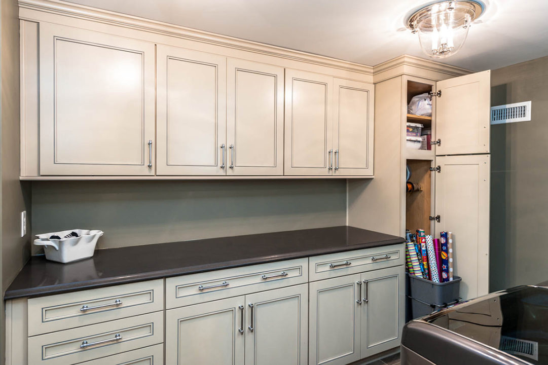 spacious laundry room, custom storage cabinetry, countertops for folding or wrapping gifts