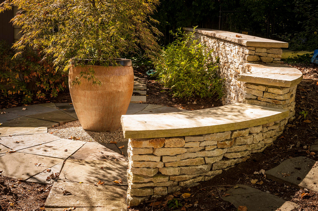 limestone patio, curved seating wall