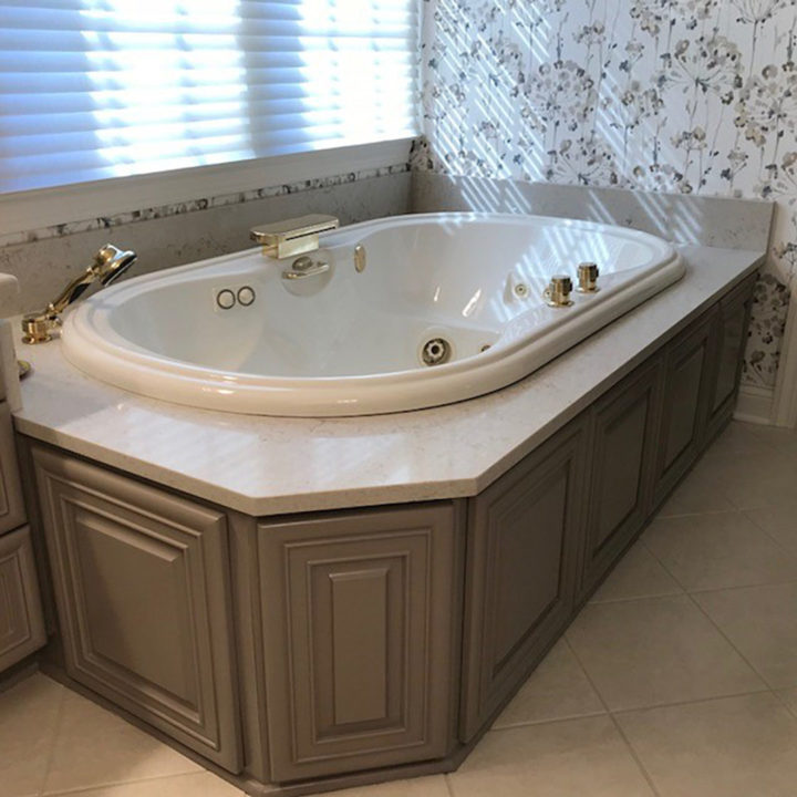bathroom refresh, bath update, master bath, Whirlpool tub and tub deck, Caesarstone, floral wallpaper