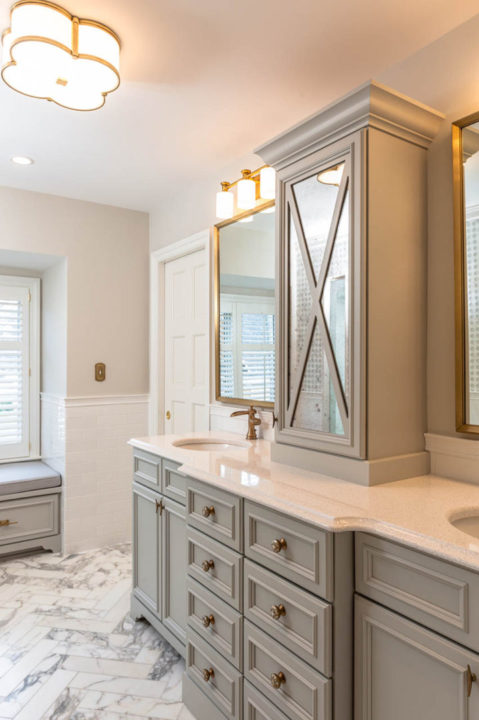 double vanity, linen tower, bronze plumbing, quartz countertops, window seat