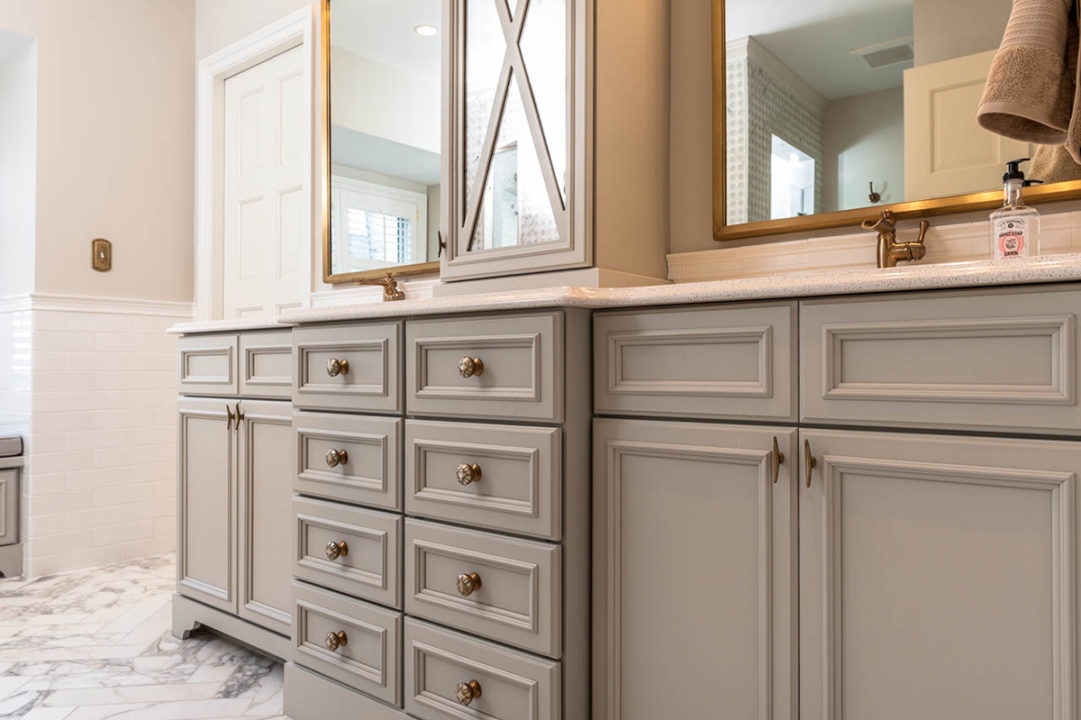 double vanity, linen tower, bronze plumbing, quartz countertops