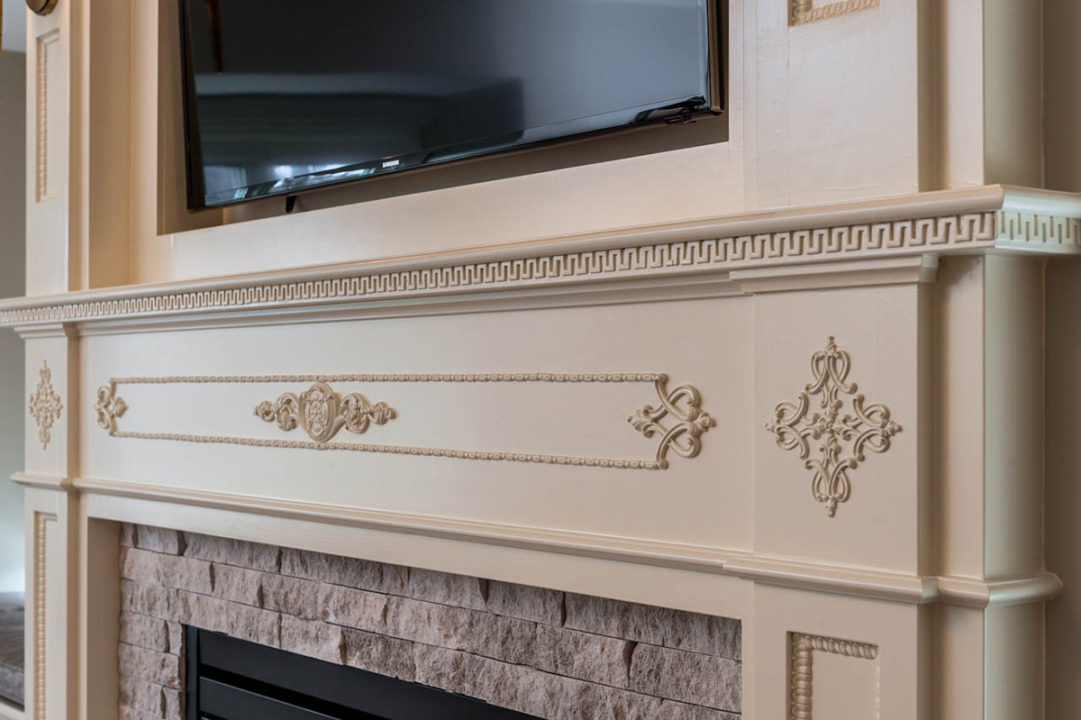 fireplace, mantle, stone fireplace surround, electric fireplace, custom mouldings, custom trim details