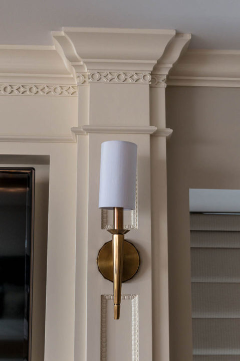 lighting, sconce, custom mouldings, custom cabinetry, custom trim details