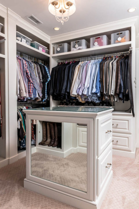 large walk-in closet, built-in dresser storage, storage island