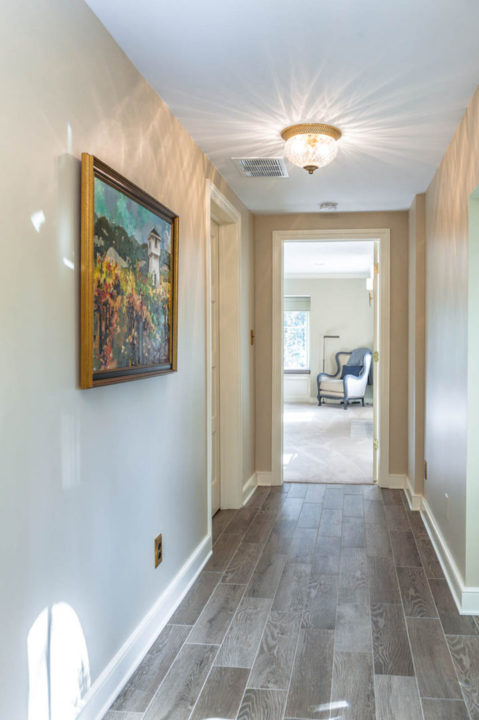sophisticated master suite private hallway