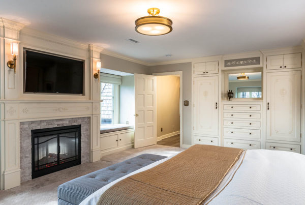 Sophisticated Master Suite Bedroom Built in Cabinet Fireplace