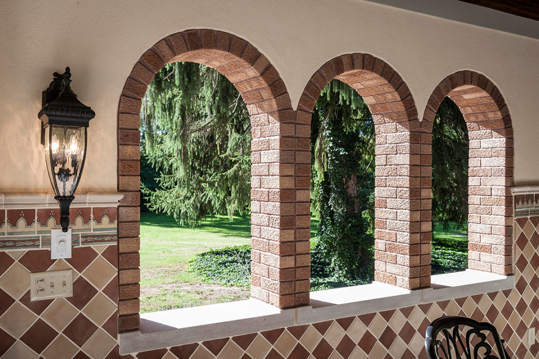 brick arched window openings, brick windows with limestone sill, tuscan style cabana, diamond stacked tile pattern