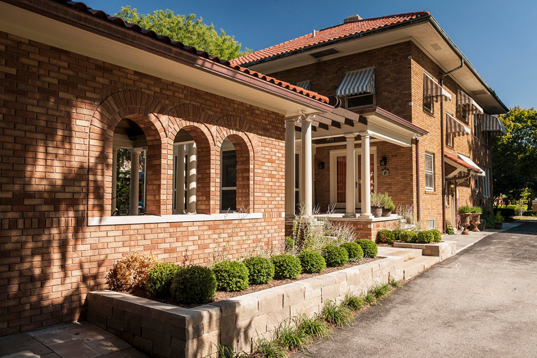 screened in porch, Tuscan style cabana, red clay terracotta shingles, terracotta clay roof, red clay roof, limestone pavers, copper gutters and spouts, limestone columns with brick pedestal, pergola