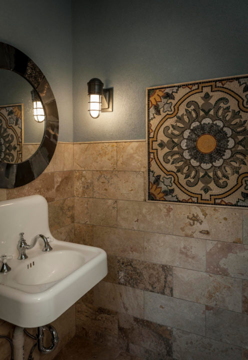 travertine tile, inset mosaic pattern, Italian mosaic tile, floral mosaic tile pattern, pencil mold trim, tile on walls, pool bath, repurposed antique sink, wall hung sink